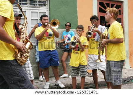 OLINDA, PERNAMBUCO/ BRASIL Â?Â? 19 FEBRUARY 2012  Musicians during the frevo carnival in the old town of Olinda in Northeast of Brasil in 2012, one of important carnivals in Brasil. - stock photo