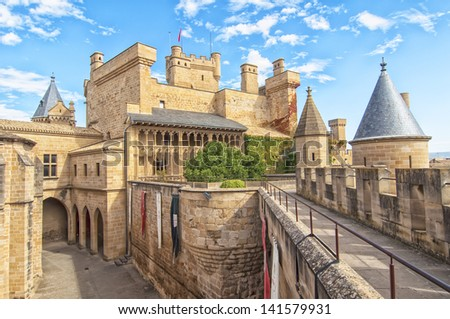 Olite Castle with a sky of clouds in Navarra, Spain - stock photo