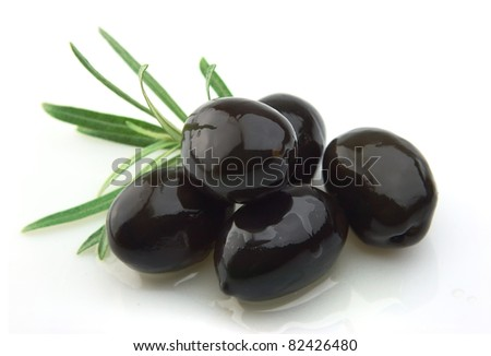 olive branch with olive oil close up - stock photo