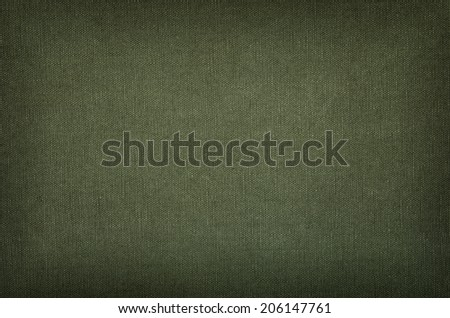 Olive green cotton texture with vignette - stock photo