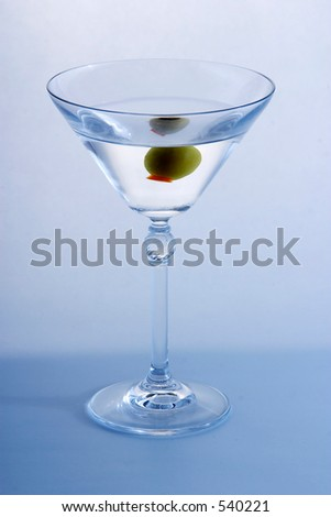 Olive in a martini - stock photo