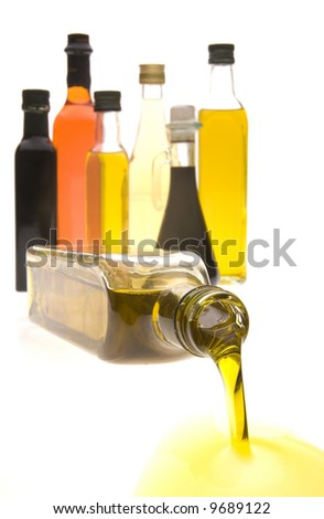 Olive oil and Balsamic vinegar bottles isolated on a high white background - stock photo