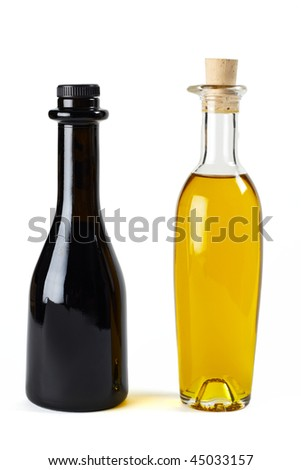Olive oil and balsamic vinegar in nice bottles - stock photo