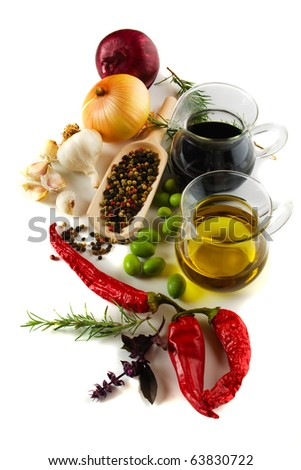 Olive oil and balsamic vinegar with mediterranean spices isolated on white - stock photo