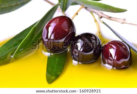 Olive oil and branch of olives.Greek food.Food background. - stock photo