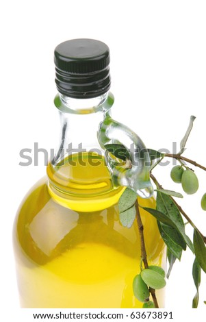 olive oil and olives on white background