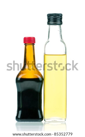 Olive oil and soy sauce bottle isolated on white background - stock photo