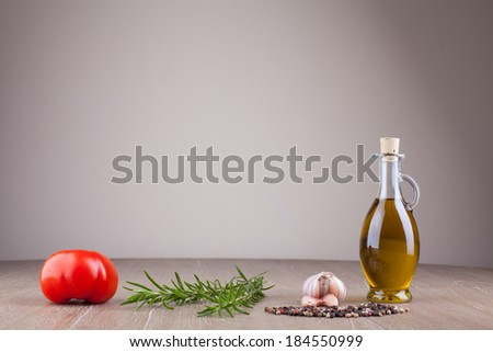 olive oil and spices on wooden table horizontal