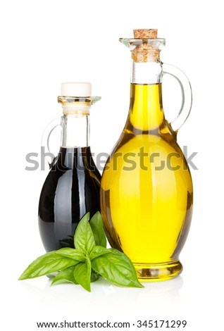 Olive oil and vinegar bottles with basil. Isolated on white background - stock photo