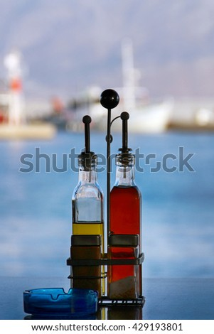 Olive Oil, Balsamic Vinegar in Table Seasoning Set at the Restaurant/Seasoning Set on the Table - stock photo