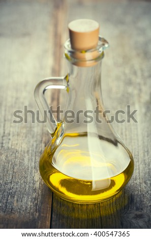 Olive oil bottle on wood table