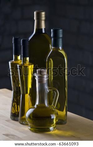 Olive oil bottle still-life over dark  background - stock photo