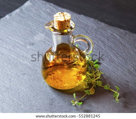 Olive oil bottle with oregano spice herb