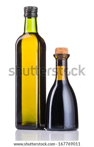 olive oil bottles isolated on white - stock photo
