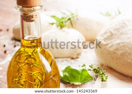 olive oil, herbs and pizza dough - stock photo