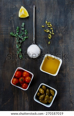 Olive Oil, herbs and vegetables on a Wooden Background. Vegetarian food, health or cooking concept. Top view. - stock photo