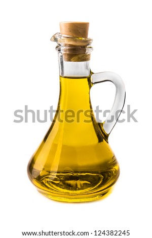 Olive oil in a bottle on white - stock photo