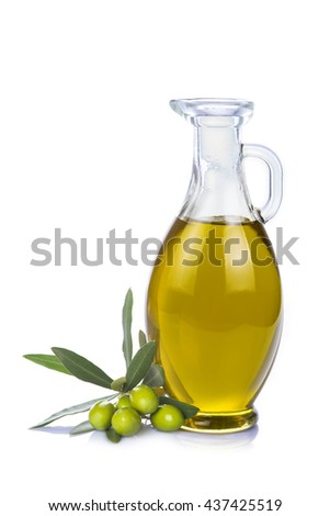 Olive oil in a glass bottle and green olives isolated over a white background - stock photo