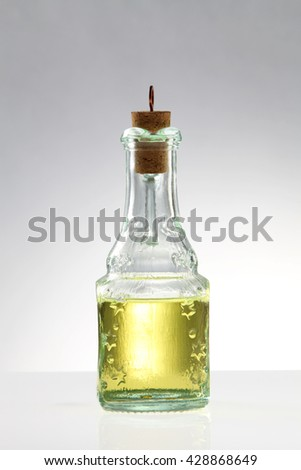 olive oil in bottles on the white background