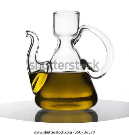 olive oil in carafe - stock photo