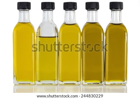 Olive Oil in Five Bottles and Different Colors