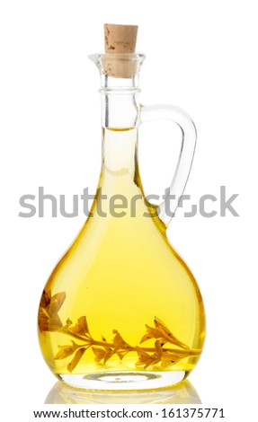 Olive oil in glass jug isolated on white background - stock photo