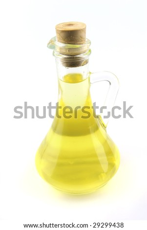 olive oil in jug over white background