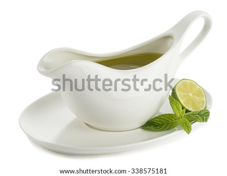 Olive oil in porcelain cup.  - stock photo
