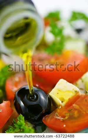 olive oil in salad closeup - stock photo