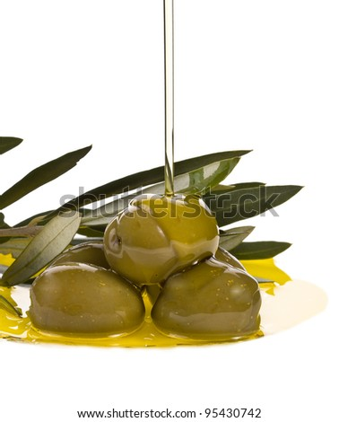Olive oil jet over a olive branch isolated on white background - stock photo