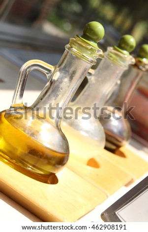 Olive oil, lemon juice and pomegranate vinegar for salads