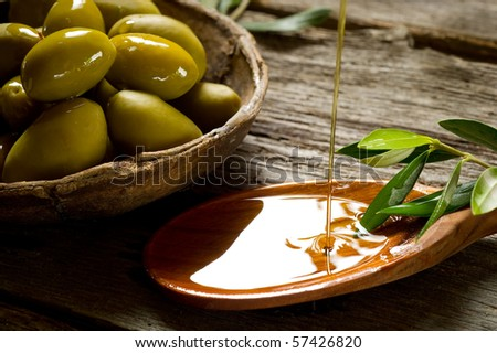 olive oil over spoon - stock photo