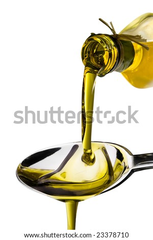 Olive oil poured from an original bottle into a spoon  isolated on white background - stock photo