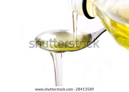 Olive oil poured  into a spoon - stock photo