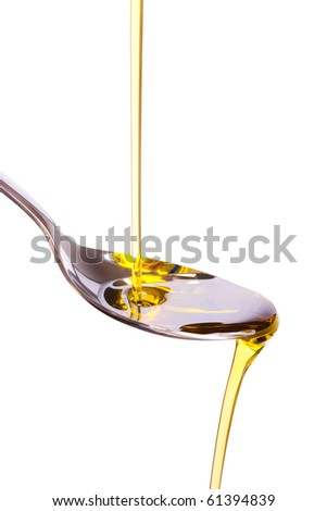 olive oil poured into spoon - stock photo