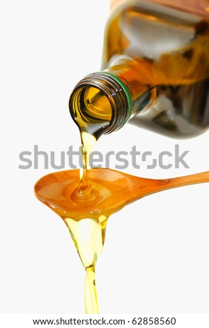 Olive Oil pouring from a bottle - stock photo