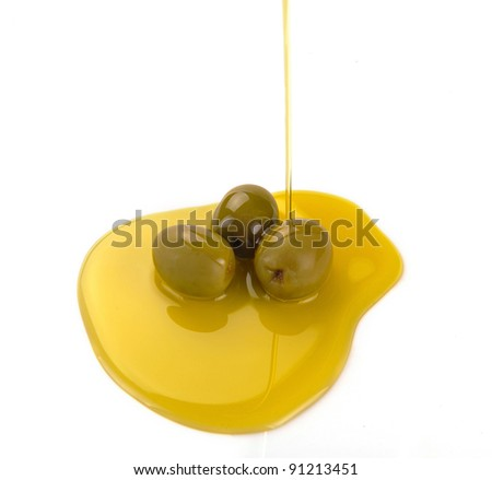 Olive oil pouring out. Pouring olive oil - stock photo