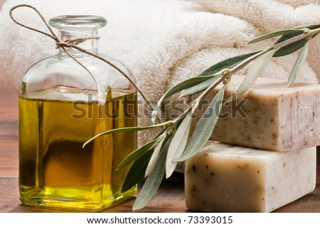 Olive oil soap and bath towel - stock photo