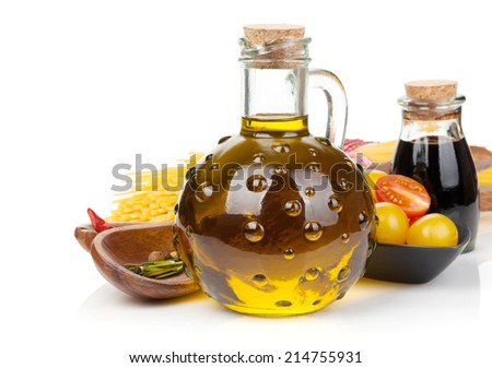 Olive oil, vinegar, tomatoes and pasta. Isolated on white background - stock photo