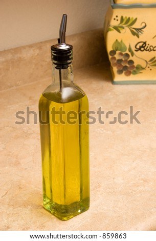 olive oil with biscotti background - stock photo