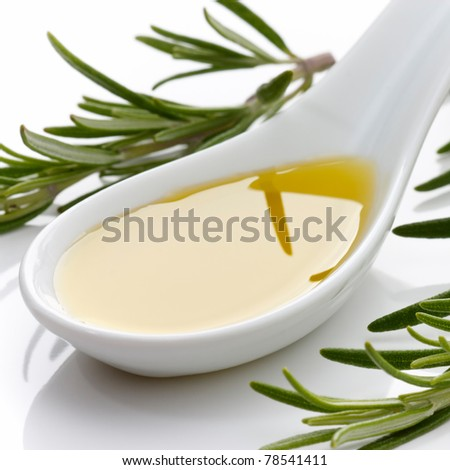 Olive oil with fresh rosemary and white background.