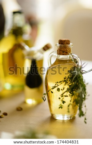 olive oil with herbs - stock photo