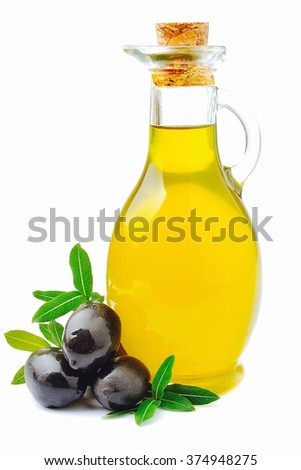 Olive oil with olives close up on white
