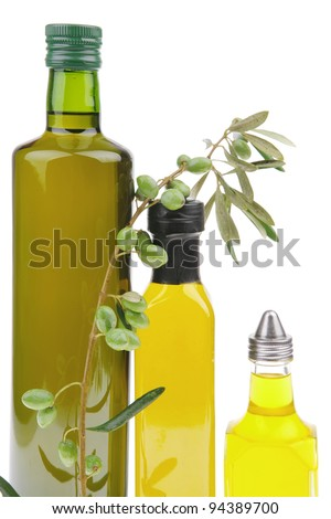 olive oil with olives over white background