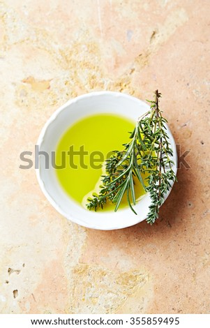 Olive oil with thyme and rosemary - stock photo