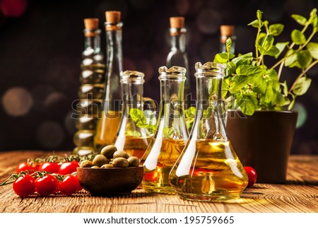Olive oils in bottles. Food ingredients - stock photo