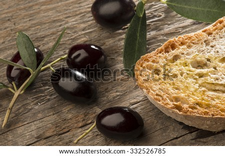 olive on the wooden table - stock photo
