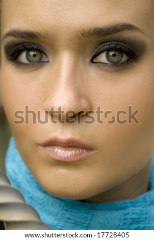 Olive skinned European beauty with green eyes with turquoise scarf - stock photo