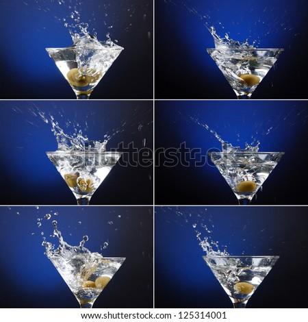 olive splashing into a martini - stock photo