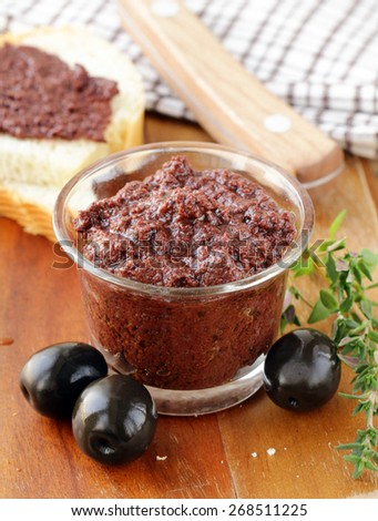 olive tapenade of black olives with herbs and spices - stock photo